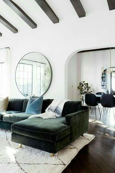 Bright white living room with tall beamed ceilings