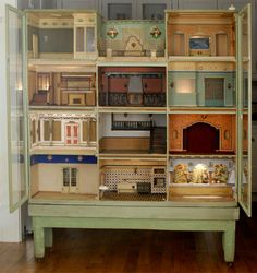 JT- I would love to own this absolutely wonderful Spanish Cabinet Dolls house, circa 1925-1930. It has eleven beautiful appointed rooms (esp. love bottom right) and an open terrace on the fourth floor. Click for closer look!)