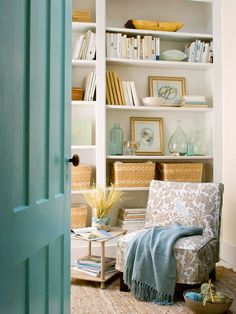love the colors in the room and shelf arrangements