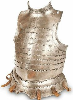 "German ""anime"" cuirass (breastplate), circa 1590, articulated with high neck and narrow plate, each lame shaped and filed on the top edge with oges and cusps, and with rope work rolled edges, the top of the breast plate engraved with the cross of the Knights of St John, suspended by a chain, with six buff leather straps at the base for the tassets."