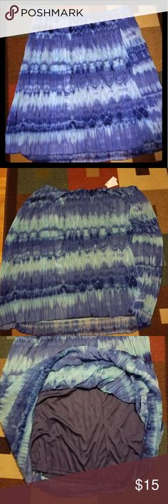 """Tye Dye skirt This gorgeous blue skirt is 31"""" long and has a built in lining.  Still had the tags on it and has never been worn. Full skirt with an elastic waist Avenue Skirts A-Line or Full"""
