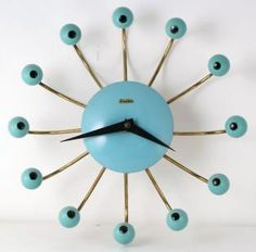"""Don't be afraid of time! Several years ago a visitor to The Canadian Clock Museum recalled that her grandmother had a wall clock with twelve eyes that stared at her as a little girl, and she never forgot it. Must have been a Snider spider! [Image: ca. late 1950s """"spider"""" electric wall clock. From the collection of the Canadian Clock Museum]"""