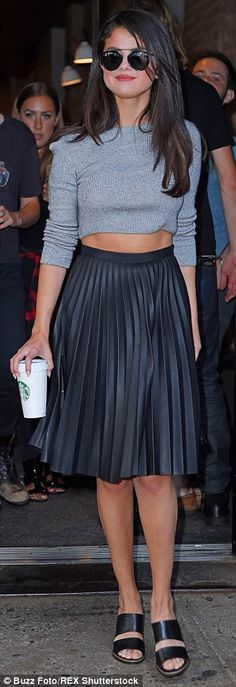 Flashing the flesh: The singer showed off her flat stomach and slender legs as she grabbed...