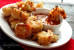 Coconut shrimp paired with a fruit infused dipping sauce. #HealthySnacks http://heelsandhelmets.com/healthy-snacks-for-sport-events/