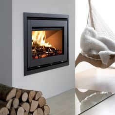 The Westfire Uniq 32 Wood Burning Inset Stove is a showpiece stove with a widescreen landscape front. The large cleanburn chamber gives excellent results for such a large stove. With a moderate output of up to the Westfire Uniq 32 woodburner is Inset Fireplace, Log Burner Fireplace, Wood Burning Fireplace Inserts, Wood Burner, Modern Fireplace, Fireplace Design, Scandinavian Fireplace, Fireplace Ideas, Inset Log Burners
