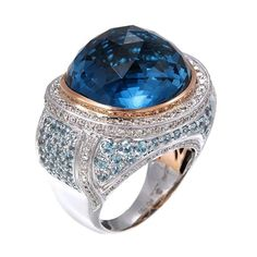 A large blue topaz centers this 18k white gold and palladium ring surrounded by diamonds and natural blue zircon by @zorabcreation http://zorabcreation.com/