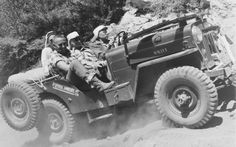 Jeep CJ-3B taking on the Rubicon Trail at a Jeepers Jamboree.