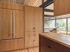 The interior remodel of a midcentury home in central Seattle featuring a new indoor pool and free flowing spaces. By SHED Architecture & Design. Mid Century Modern Kitchen, Mid Century Modern Living Room, Mid Century House, Modern Kitchen Design, Modern House Design, Kitchen Designs, Midcentury Sheds, Home Renovation, Home Remodeling