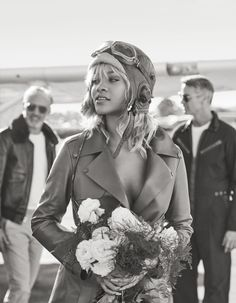 Channeling Amelia Earhart, Rihanna wears Tod's leather trench coat