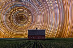 Long Exposure of Star Trails against a Farmhouse