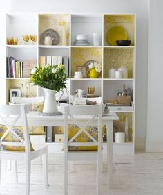 Square bookcases can have a place in the kitchen/dining room as a way to store extra serving pieces, cookbooks, and more..