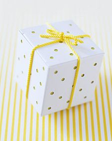 With a circle hand punch, make holes in flattened box. Make two paper liners, one 8 by 1 7/8 inches, the other 6 by 1 7/8 inches. Score liners with bone folder at 2-inch intervals; slip inside box to cover all sides. Tie with rayon cording or ribbon
