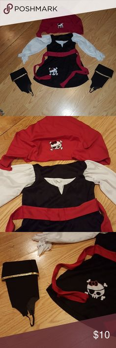 3T Pirate Costume 3T Pirate Halloween costume. Dress, bandana and pirate booties to attach to shoes. My daughter only wore this for about 3 hours. Great condition. Will ship next day, arriving in time for Halloween! Costumes Halloween