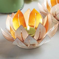 Gilded Lotus Votive Holder - add an atmosphere of tranquility with this exquisite gold-tone metal lotus flower holder. Glass cup holds a votive or tealight, sold separately. #Weddings #HomeDecor #candles