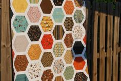 Hexagon quilt with great tutorial. Also on moda bakeshop another view with borders.