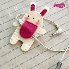 "Earphones Holder (hand~stitched of two layers of felt; tiny sew~on snap beneath ""tummy flap"")"