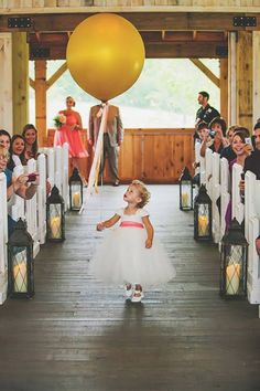 6 Things Your Flower Girl Can Carry Down the Aisle Besides Petals