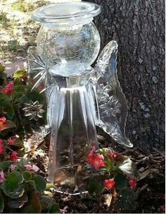 A wonderful garden angel from cut glass globe, candle holder, vase and relish servers!