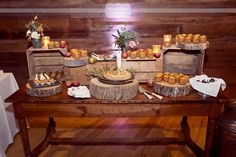 Rustic dessert table at the Inn at Round Barn Farm with wooden crates and thick tree slices as platforms!  Love the single serving apple pie in ball jars and creme brulee spoons.  #roundbarn #uniquedesserts