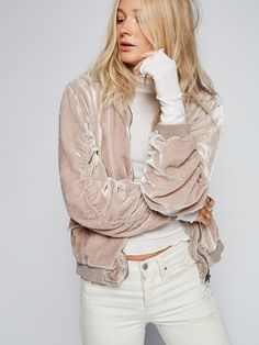 Ruched Velvet Bomber   Ultra cool crushed velvet bomber jacket with ruched detailing on the sleeves and ribbed trim. Front zipper closure and hip pockets with snaps. Easy silky lining.