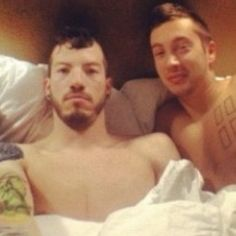 i need to know what is happening in this photo...they are both shirtless and under covers in the same bed. explain!