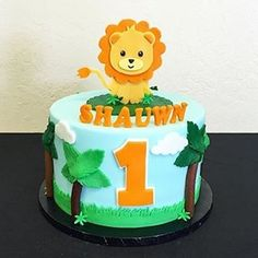 Cute Lion fondant first birthday cake!
