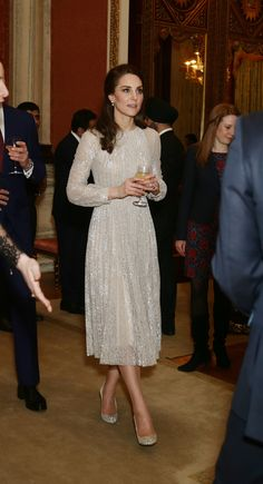 Kate Middleton in Erdem's icy frock with flecks of metallic threading, and upped the princess quotient with sparkling Oscar de la Renta stilettos.