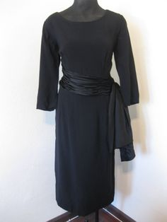 This dress deserves some love! Swanky!  https://www.etsy.com/listing/170532332/stunning-1950s-black-crepe-cocktail