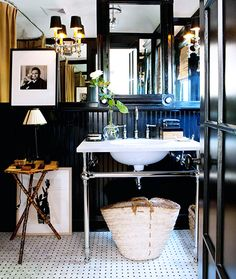 black bathroom with black and white tile and bamboo table // bathrooms // interior designer Mark D. Sikes