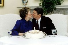 PHOTO MARCH 1985 - President Ronald Reagan and his wife Nancy kiss on their wedding anniversary in the White House March 4 1985. Ronald Reagan, the film star turned politician, swept into office as the 40th U.S. president on a conservative revival that changed America's political and economic landscape for years to come