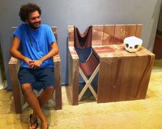Designer Mr Simon at the Valencia Design Week. Photo Credit: Petz Scholtus Several folding chairs form a table when stored away. I particularly like the way they used the wood and textile, and printed the chairs to create one solid piece when stacked together.