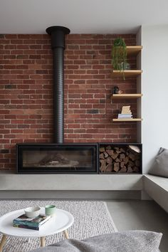 Thomas + Williams Architects - Hilary Bradford Photography Industrial Fireplaces, Home Fireplace, Home, House Design, Fireplace Design, Wood Heater, Living Room With Fireplace, Exposed Brick Fireplaces, Freestanding Fireplace