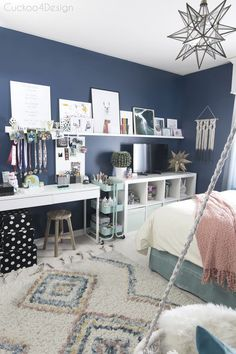 kids crafting and coloring storage solution in a dark blue girls bedroom