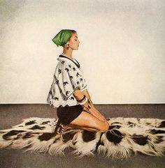 Jean Patchett in elephant print beach shirt worn with black shorts by Carolyn Schnurer, photo by Louise Dahl-Wolfe, Harper's Bazaar, December 1952