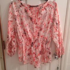 Ivanka Trump Flowered Blouse Ivanka Trump pink flowered blouse. Keyhole with tie and top. Cinched waste Ivanka Trump Tops Blouses