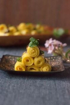 Khandvi is a gluten free snack bite from India made with yogurt and chickpea flour.