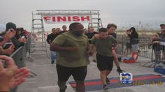 Marine honored for carrying triathlete across finish line~~~Pensacola, FL posted on Oct 26, 2012