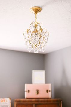 220 best lighting in nursery images on pinterest child room sweet feminine nursery in peach gold and gray aloadofball Image collections