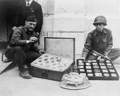Monument Men:  First Lieutenant James J. Rorimer, at left, and Sergeant Antonio T. Valin examine recovered objects. Neuschwanstein, Germany, May 1945. Photograph by U.S. Signal Corps