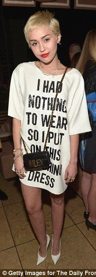 Miley's Dress — Moschino — Battle of the superstars: Katy Perry, Rihanna and Miley Cyrus were all in attendance at Th...