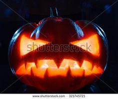 Smoking scary halloween pumpkin head. studio shot