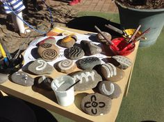 Aboriginal symbols on rocks for children to play with. NAIDOC week.