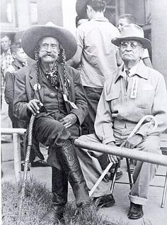 Pistol Pete (on left) at Dewey, Oklahoma. He is the inspiration for the University of Oklahoma's mascot.