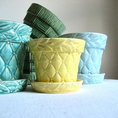 This sweet yellow flower pot by McCoy has a diamond quilted pattern on its sides and foliate band around the rim.