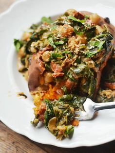 Braised coconut spinach and chickpeas with lemon over baked sweet potato