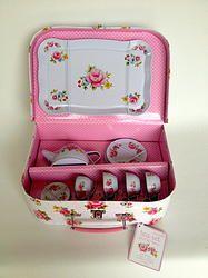 Children's tea set in a flower case