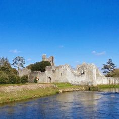 Adare, Ireland, the Desmond castle on the banks of the river