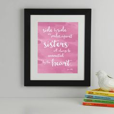 Artwork in Flamingo Pink in a Black Frame