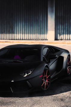 .The Sexy Matte Black #Aventador car with red details on wheel.