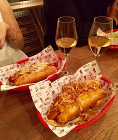 Sloppy joe and Mac daddy hot dogs with champagne at Bubbledogs, London.